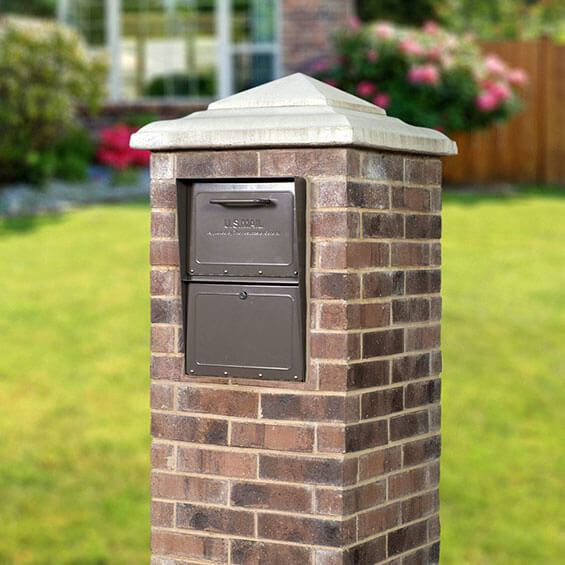 Rich bronze locking mailbox installed in brick