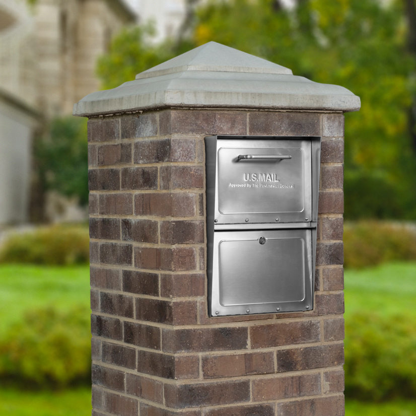 Stainless steel locking mailbox installed in brick