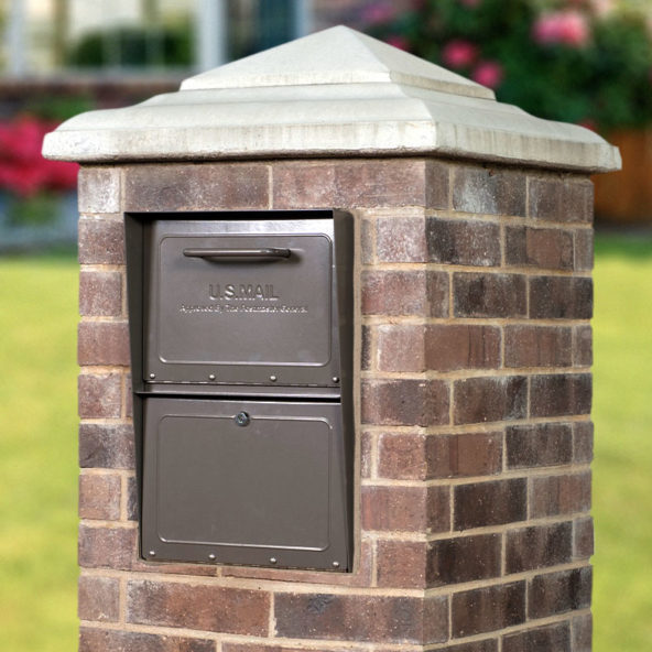 Bronze locking mailbox installed in brick