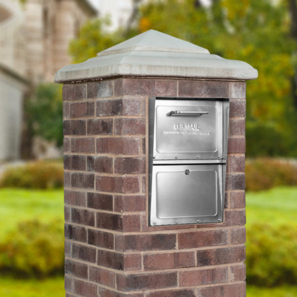 Stainless Steel locking mailbox installed in brick